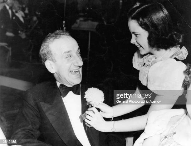 Comic actor Jimmy Durante with child star Judy Garland the entertainer and leading lady