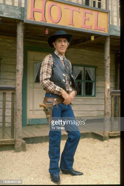 Comic actor Peter Cook dressed as cowboy Lee Van Wrangler on the set of television comedy special Peter Cook & Co., circa 1980.