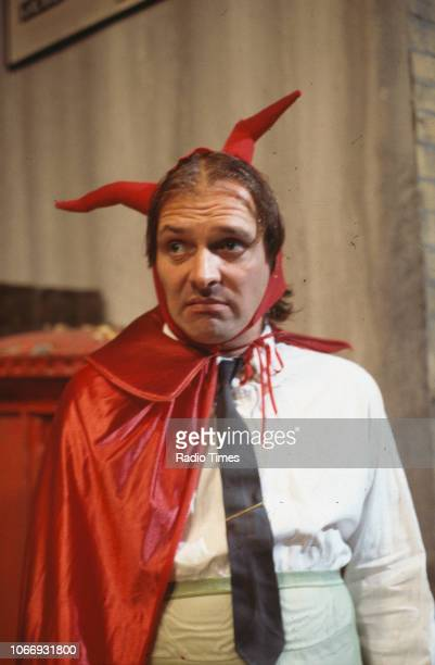 Comic actor Rik Mayall wearing a devil costume in a scene from episode 'Accident' of the BBC television sitcom 'Bottom', July 12th 1991.