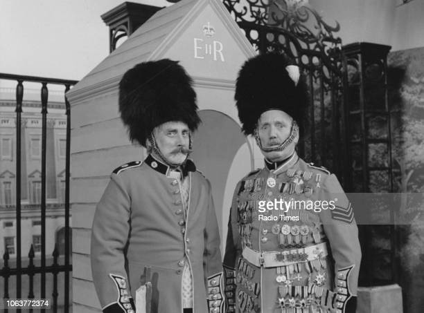 Comic actor Spike Milligan and another actor dressed as soldiers of the Queen's Guard, in a sketch for the television show 'Q9', September 14th 1979.