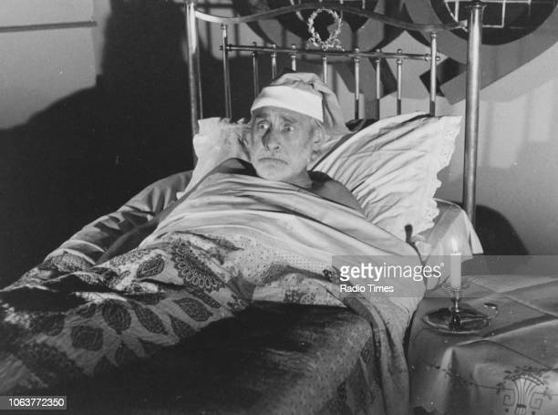 Comic actor Spike Milligan lying in bed with a candle in a sketch for the television show 'Q9' September 7th 1979