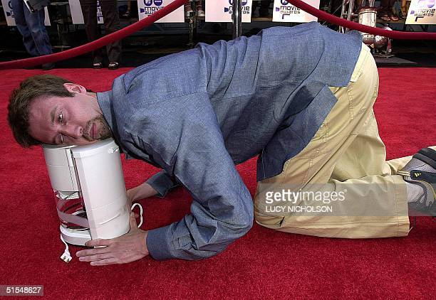 US comic actor Tom Green jokes with a coffee maker as he arrives to be a presenter at the MTV Movie Awards at the Sony Studios in Culver City CA 03...