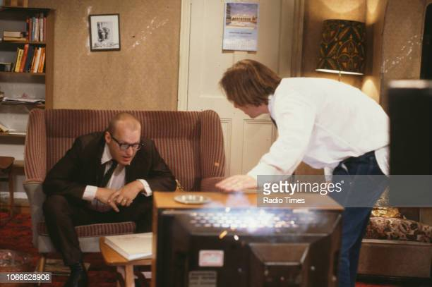 Comic actors Adrian Edmondson and Rik Mayall destroying a television in scene from episode 'Contest' of the BBC television sitcom 'Bottom' June 24th...