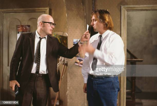 Comic actors Adrian Edmondson and Rik Mayall in a scene from episode 'Accident' of the BBC television sitcom 'Bottom', July 12th 1991.