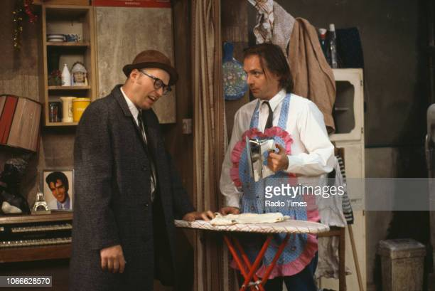 Comic actors Adrian Edmondson and Rik Mayall in scene from episode 'Burglary' of the BBC television sitcom 'Bottom', May 25th 1992.