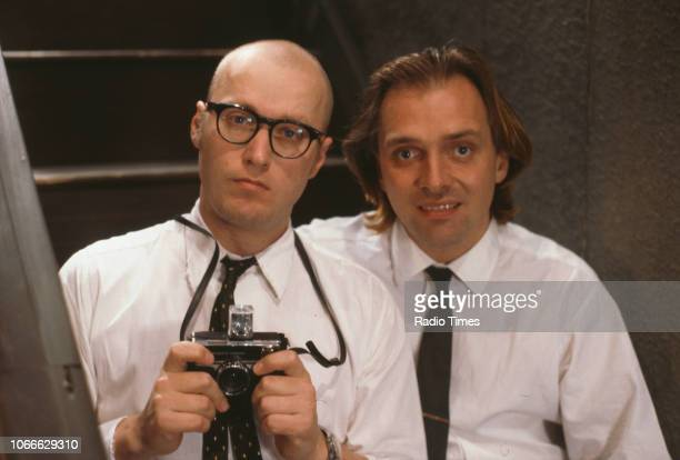 Comic actors Adrian Edmondson and Rik Mayall pictured on the set of episode 'Gas' for the BBC television sitcom 'Bottom', July 4th 1991.