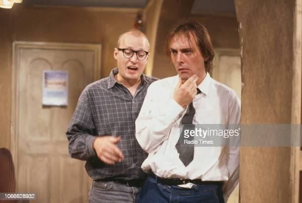 Comic actors Adrian Edmondson and Rik Mayall rehearsing on the set of episode 'Contest' for the BBC television sitcom 'Bottom', June 24th 1990.