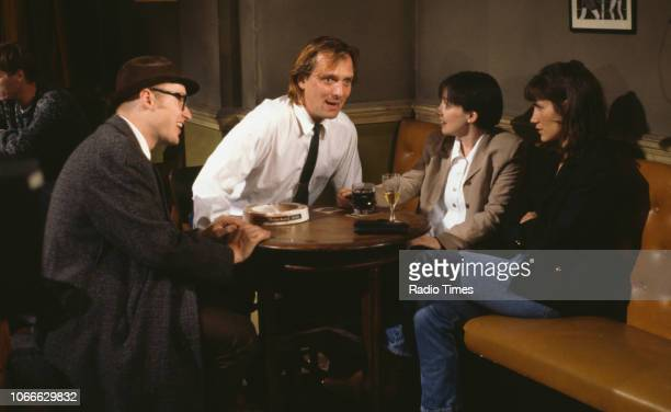 Comic actors Adrian Edmondson Rik Mayall Cindy Shelley and Carla Mendonca in a pub scene from episode 'Smells' of the BBC television sitcom 'Bottom'...