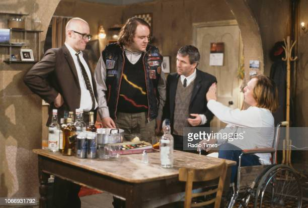 Comic actors Adrian Edmondson, Steven O'Donnell, Christopher Ryan and Rik Mayall in a scene from episode 'Accident' of the BBC television sitcom...