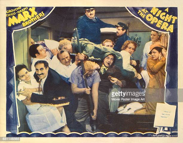 Comic actors Chico Harpo and Groucho Marx star in the 1935 Marx Brothers comedy 'A Night at the Opera' directed by Sam Wood for MGM