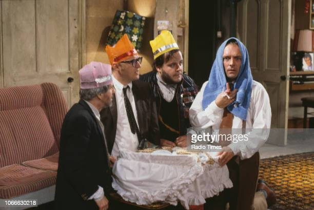 Comic actors Christopher Ryan, Adrian Edmondson, Steven O'Donnell and Rik Mayall in a nativity scene from episode 'Holy' of the BBC television sitcom...