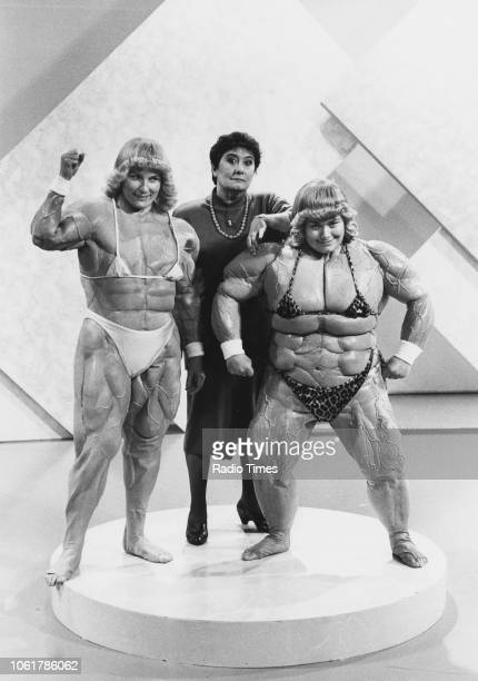 Comic actors Dawn French and Jennifer Saunders wearing muscle suits with broadcaster Mavis Nicholson in a sketch from the television comedy show...