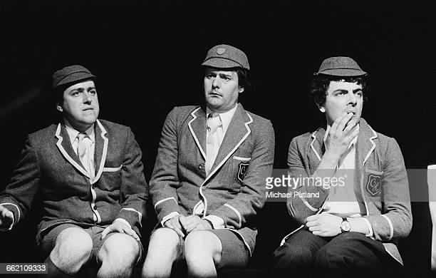 Comic actors Griff Rhys Jones John Fortune and Rowan Atkinson performing the 'Top of the Form' sketch in 'The Secret Policeman's Other Ball' at the...