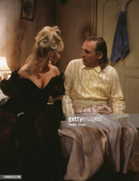 Comic actors Helen Lederer and Rik Mayall in a scene from episode 'Digger' of the BBC television sitcom 'Bottom', July 17th 1992.