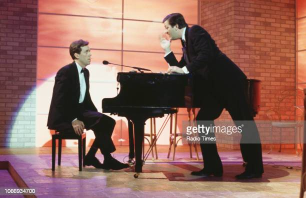 Comic actors Hugh Laurie and Stephen Fry in a piano sketch from the BBC television series 'A Bit of Fry and Laurie', April 15th 1994.