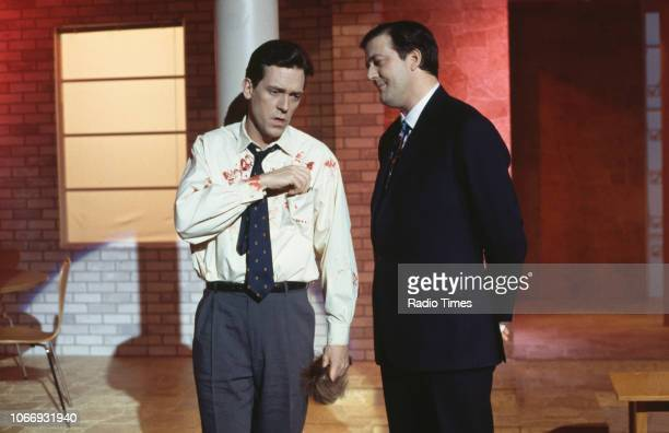 Comic actors Hugh Laurie and Stephen Fry in a sketch from the BBC television series 'A Bit of Fry and Laurie', March 15th 1994.