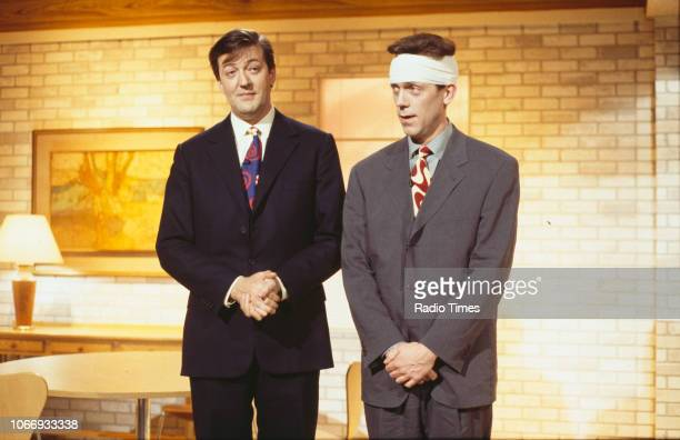 Comic actors Hugh Laurie and Stephen Fry in a sketch from the BBC television series 'A Bit of Fry and Laurie', March 22nd 1994.