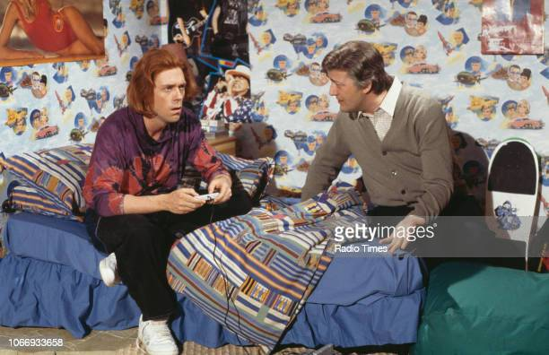 Comic actors Hugh Laurie and Stephen Fry in a sketch from the BBC television series 'A Bit of Fry and Laurie', April 12th 1994.