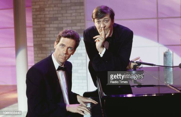 Comic actors Hugh Laurie and Stephen Fry sitting at a piano in a sketch from the BBC television series 'A Bit of Fry and Laurie', March 22nd 1994.
