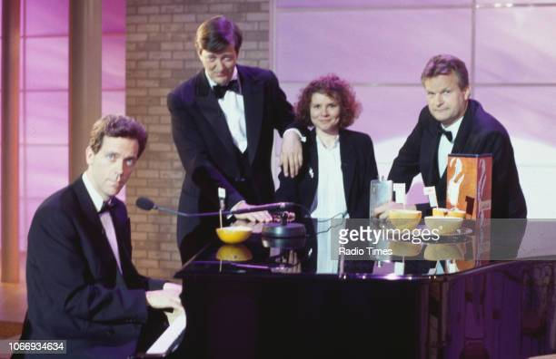 Comic actors Hugh Laurie Stephen Fry Imelda Staunton and Clive Mantle standing around a piano in a sketch from the BBC television series 'A Bit of...
