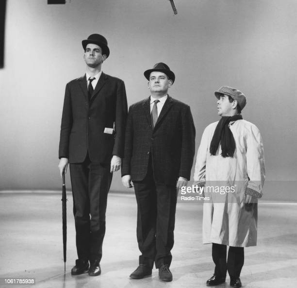 Comic actors John Cleese, Ronnie Barker and Ronnie Corbett in a sketch from the television series 'The Frost Report', March 12th 1967.