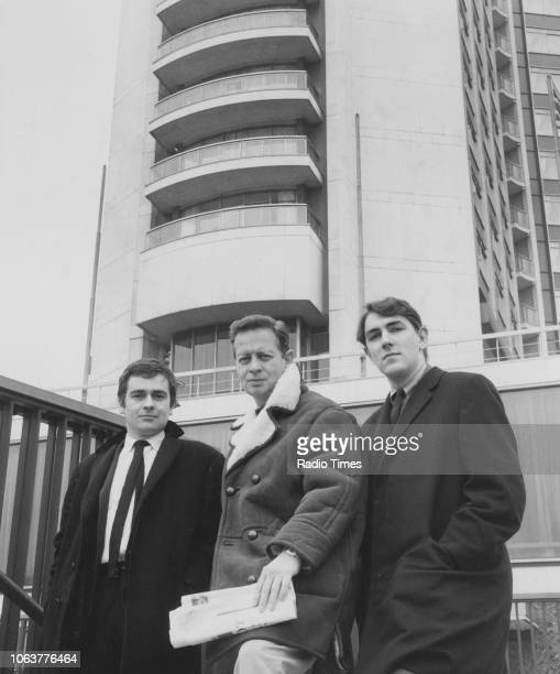 Comic actors Peter Cook and Dudley Moore pictured standing beneath a tower block February 22nd 1965