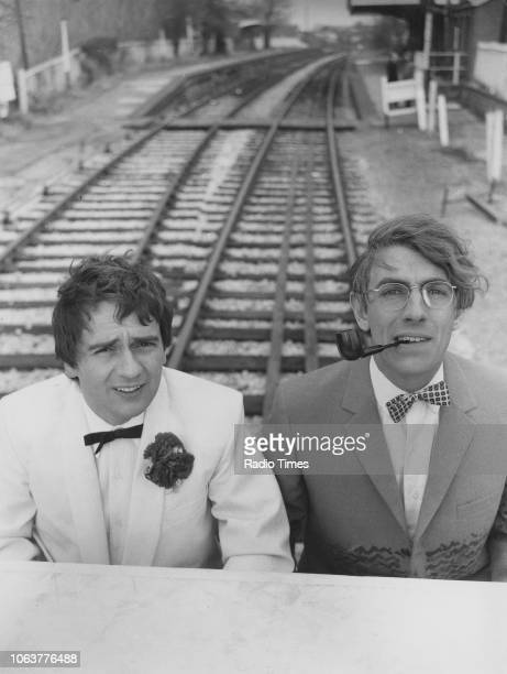 Comic actors Peter Cook and Dudley Moore playing the piano on a railway line in a scene from the television show 'Not Only But Also' November 30th...