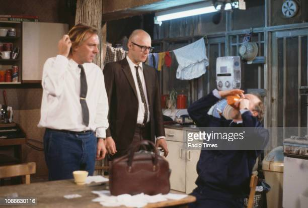 Comic actors Rik Mayall, Adrian Edmondson and Mark Lambert in a scene from episode 'Gas' of the BBC television sitcom 'Bottom', July 5th 1991.