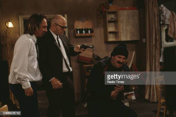 Comic actors Rik Mayall, Adrian Edmondson and Paul Bradley in scene from episode 'Burglary' of the BBC television sitcom 'Bottom', May 25th 1992.