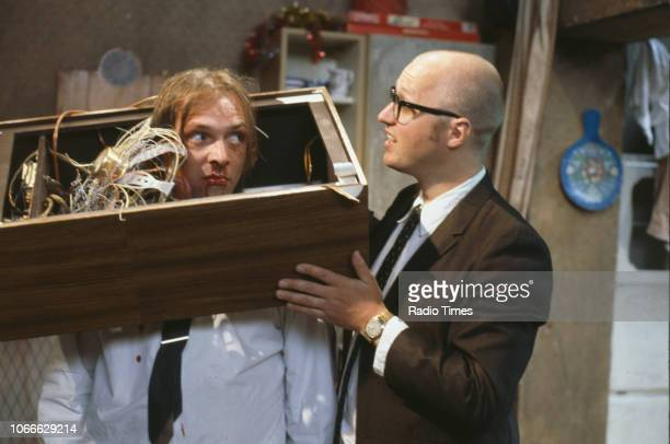 Comic actors Rik Mayall and Adrian Edmondson destroying a television set in a scene from episode 'Culture' of the BBC television sitcom 'Bottom' May...
