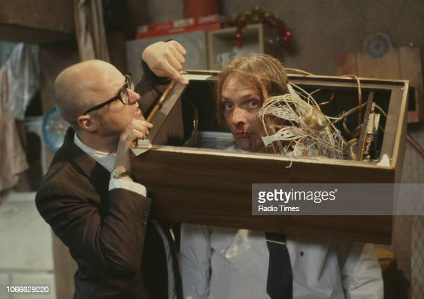 Comic actors Rik Mayall and Adrian Edmondson destroying a television set in a scene from episode 'Culture' of the BBC television sitcom 'Bottom', May...