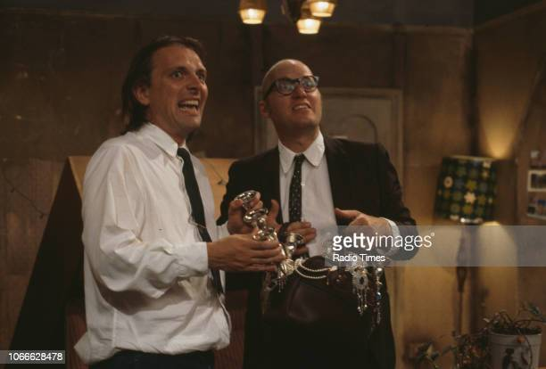Comic actors Rik Mayall and Adrian Edmondson in scene from episode 'Burglary' of the BBC television sitcom 'Bottom', May 25th 1992.
