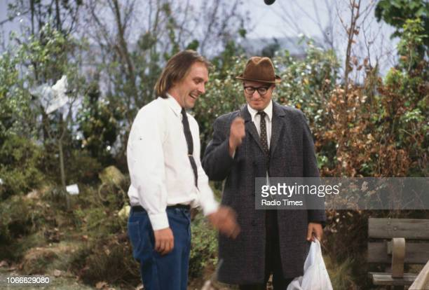 Comic actors Rik Mayall and Adrian Edmondson on Wimbledon Common in a scene from episode 'S Out' of the BBC television sitcom 'Bottom', May 11th 1992.