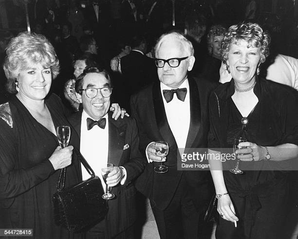 Comic actors Ronnie Barker and Ronnie Corbett with their wives, attending the premiere of a musical at the London Palladium, May 10th 1988.
