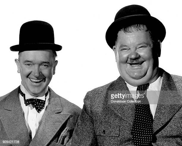 Comic actors Stan laurel and Oliver Hardy pose for a portrait circa 1935 in Los Angeles California
