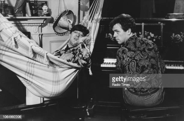 Comic actors Stephen Fry and Hugh Laurie in a scene from series 2 of the television comedy show 'A Bit of Fry and Laurie', January 21st 1990.