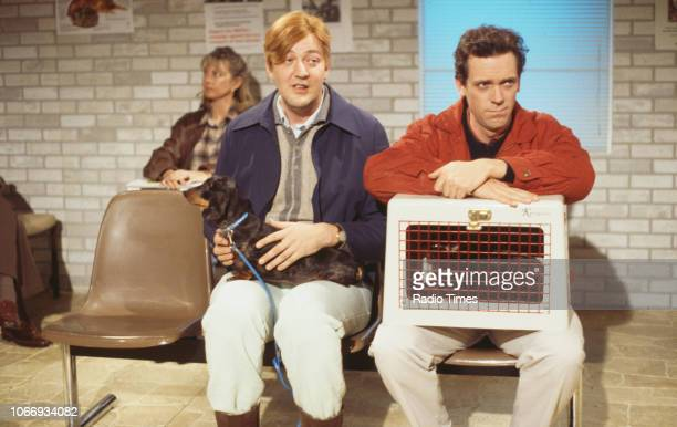 Comic actors Stephen Fry and Hugh Laurie in a vet's waiting room sketch from the BBC television series 'A Bit of Fry and Laurie', April 19th 1994.