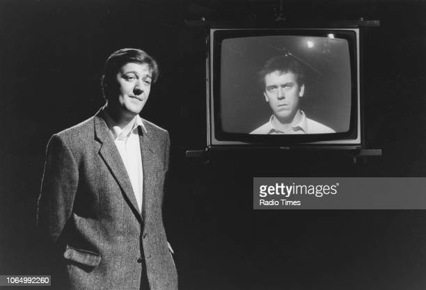 Comic actors Stephen Fry and Hugh Laurie on the set of a television show, December 17th 1988.