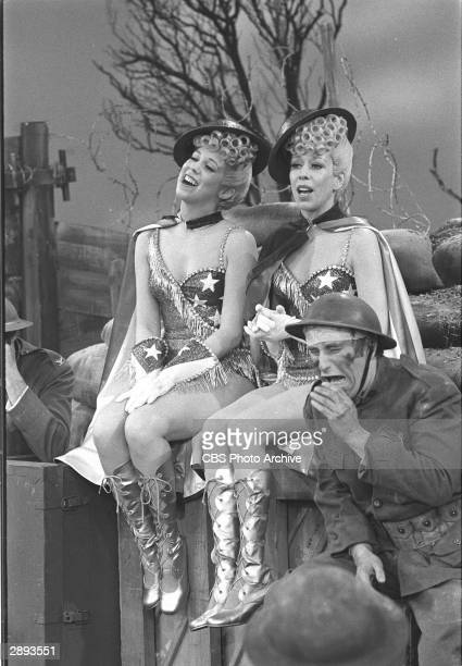 Comic actors Vicki Lawrence and Carol Burnett sing in costume in 'The Dolly Sisters' skit doing a USOstyle routine/entertainment in the trenches of...