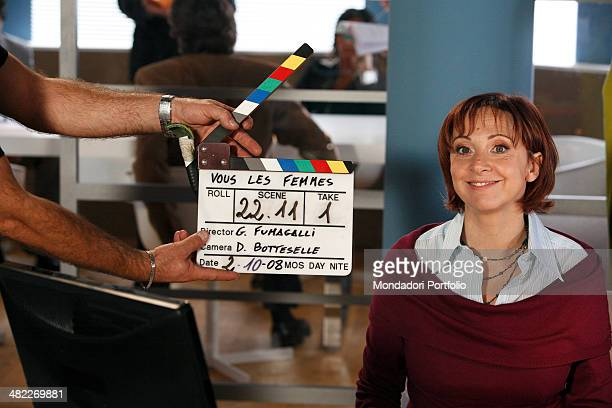 Comic actress Debora Villa poses next to a clapperboard during a photo shoot on the set of Vous les femmes in 2008 at Villa Rapazzini Arcore Italy