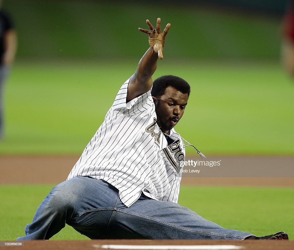 Comic and actor Craig Robinson throws out the first pitch before the Tampa Bay Rays play the Houston Astros at Minute Maid Park on May 23, 2010 in Houston, Texas.
