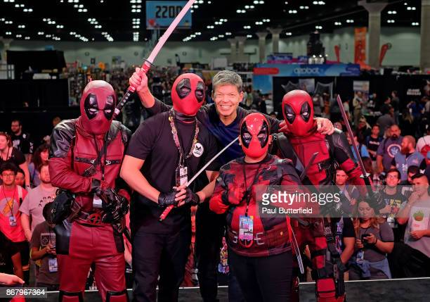 Comic book artist Rob Liefeld poses with Deadpool character cosplayers onstage Stan Lee's Los Angeles Comic Con 2017 at the Los Angeles Convention...