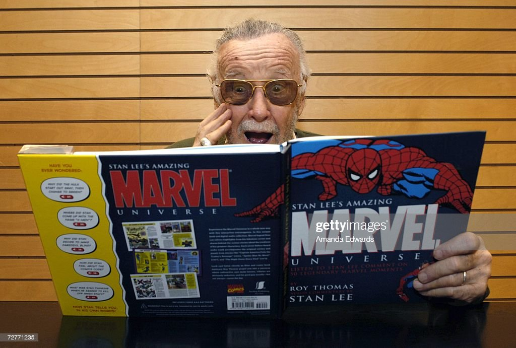 Comic Book Legend Stan Lee Signs Copies Of ''Amazing Marvel Universe'' : News Photo