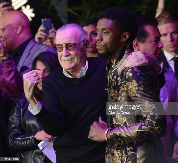 Comic Book legend Stan Lee poses with actor Chadwick Boseman on the purple carpet for the premiere of Disney and Marvel's 'Black Panther' held at the...