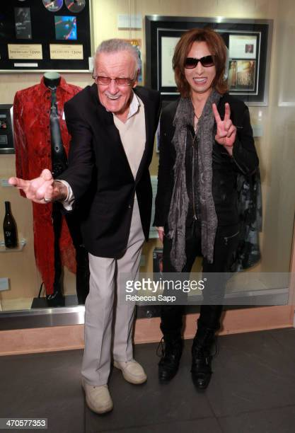 Comic book writer Stan Lee and musician Yoshiki attend Yoshiki Classical Event at The GRAMMY Museum on February 19 2014 in Los Angeles California