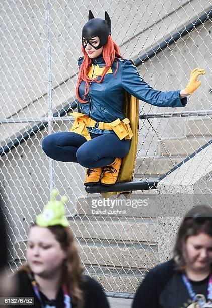 Comic Con attendee poses as Batgirl during the 2016 New York Comic Con Day 2 on October 7 2016 in New York City