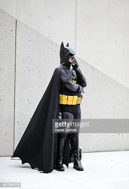 Comic Con attendee poses as Batman during the 2014 New York Comic Con at Jacob Javitz Center on October 10 2014 in New York City