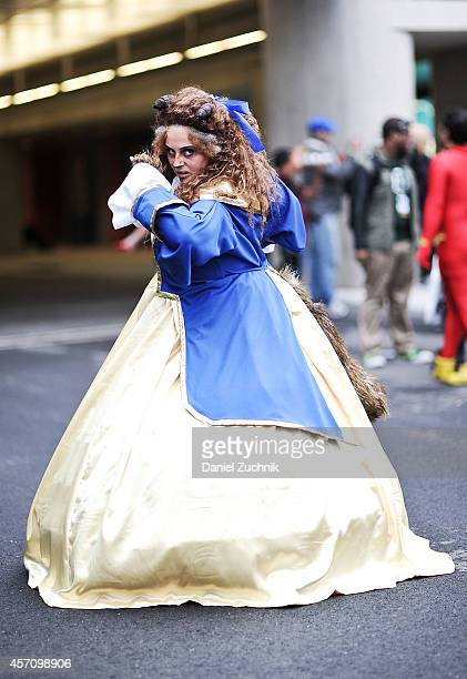 Comic Con attendee poses as Beauty and the Beast during the 2014 New York Comic Con at Jacob Javitz Center on October 11 2014 in New York City