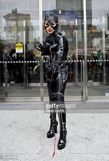 Comic Con attendee poses as Catwoman at New York Comic Con 2013 at Jacob Javits Center on October 11 2013 in New York City
