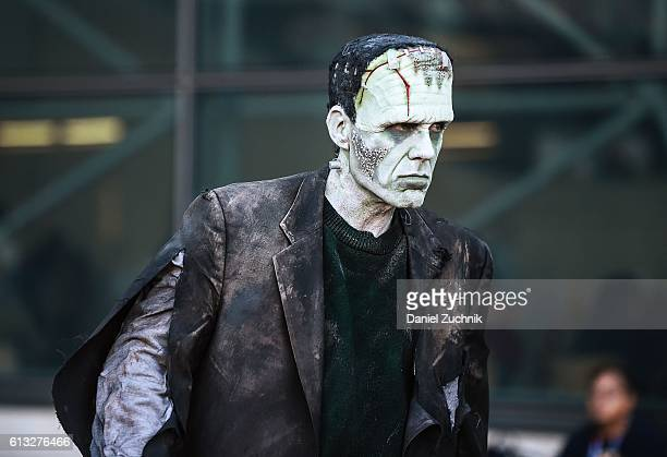 A comic Con attendee poses as Frankenstein during the 2016 New York Comic Con Day 2 on October 7 2016 in New York City